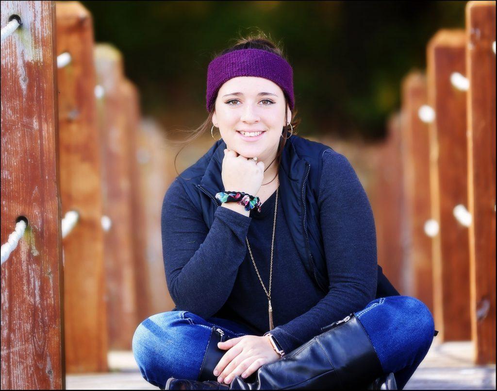 Girl wearing purple headband.